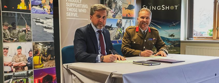 Simon Davies, CEO of Spectra Group, signing the Armed Forces Recognition Covenant